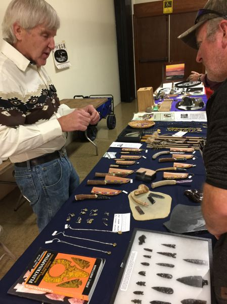 SUBMITTED PHOTO - At last year's Gem & Rock Show, Bill Krause, left, demonstrates the art of stone knapping, which involves the shaping of flint or other stones.