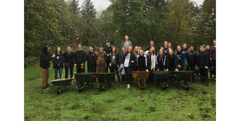 SUBMITTED PHOTO - Gladstone High School students participate in the Gladstone Gives Back event last year at Gladstone Nature Park.