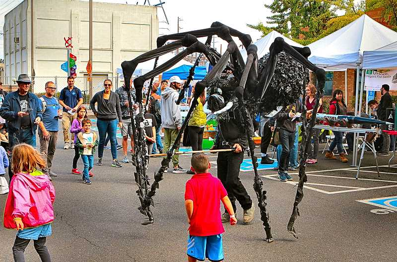 DAVID F. ASHTON - Word has it that Giant Spider-Man lives in Sellwood at Tom Dwyer Automotive, when not on display at fairs.
