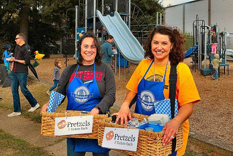 DAVID F. ASHTON - Nothing says Oktoberfest like fresh warm pretzels, and volunteers Elizabeth Richard and Liz Goodell had them!