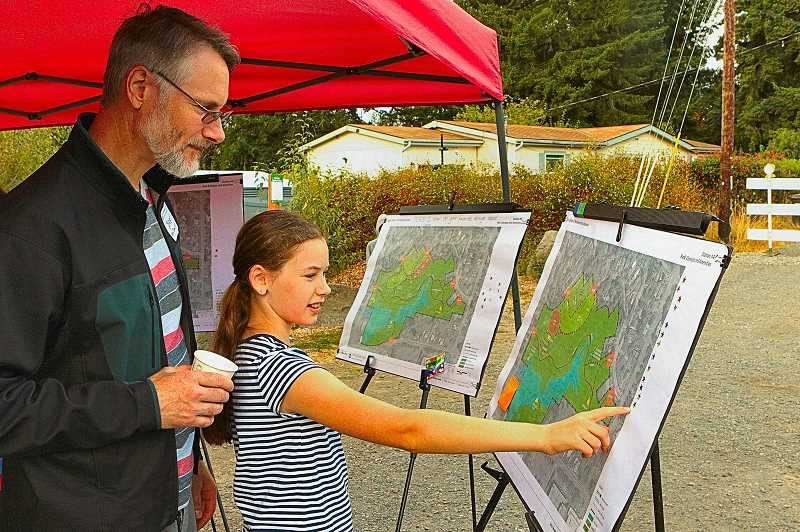 DAVID F. ASHTON - Its coming along well, says Errol Heights Park CAC member Brett Bolstad, who looks at the plans with his daughter, Saule.