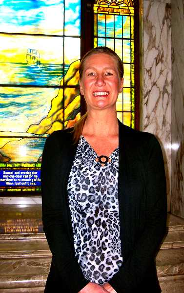 RITA A. LEONARD - Wilhelms Family Services Adviser Sarah Lewis, shown in a chapel at the Funeral Home.