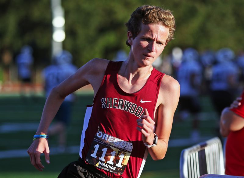 TIMES PHOTO: DAN BROOD - Sherwood senior Henry Giles ran to second place when the Bowmen hosted Libery and McMinnville in a double dual meet last week.