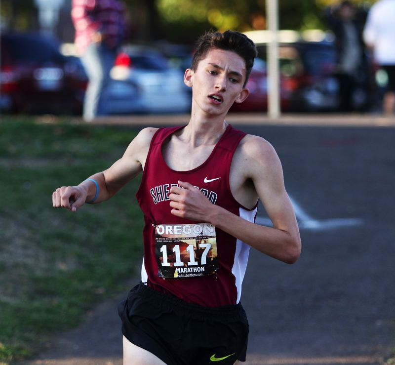 TIMES PHOTO: DAN BROOD - Junior Jaron Homer ran to third place when the Bowmen hosted Libery and McMinnville in a double dual meet last week.