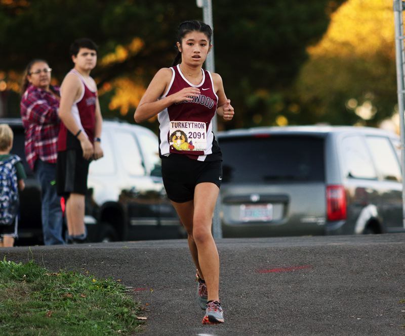 TIMES PHOTO: DAN BROOD - Sherwood High School junior Madi Ramos ran to victory when the Bowmen teams hosted Liberty and McMinnville last week.