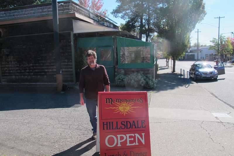 PHOTO BY BILL GALLAGHER - Where it all began.  McMenamins Historian Tim Hills at the site of Oregon's first brew pub and the parking lot that was the scene of Portland's first beer fest.