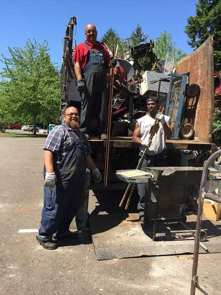 SUBMITTED PHOTO - Scrap metal brough to the Fall Clean Up on Nov. 3 will be handled  by the crew from Anfiedl & Sons Metal Recyclers.  Pictured at the Spring Clean Up are  (l to r) Jamed Anfield, Carl Anfield and David Collins.