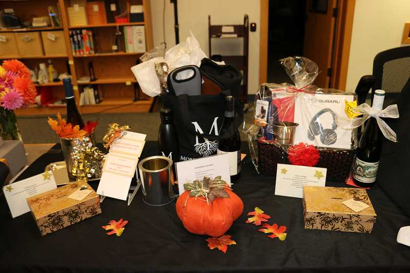 SUBMITTED PHOTO - Raffle items are a popular feature of the Toast to the Imagination event at the Wilsonville Library.