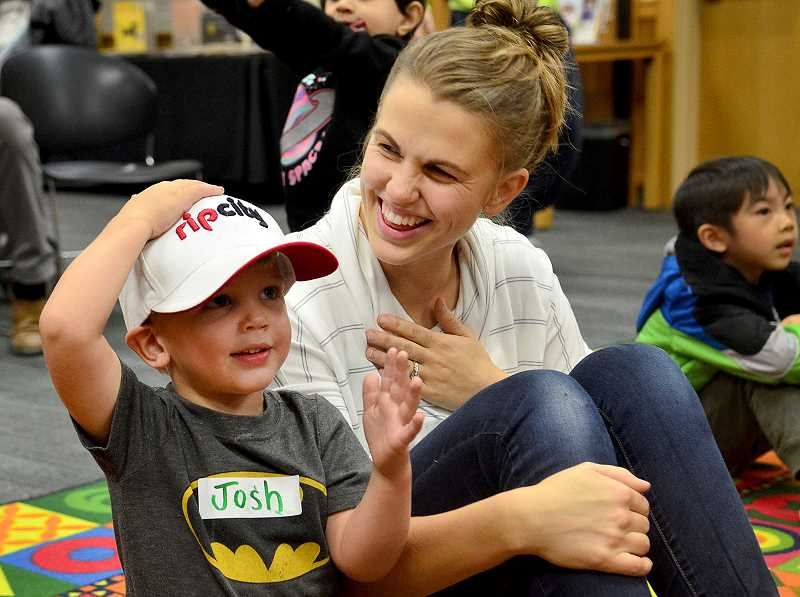 SPOKESMAN PHOTO: VERN UYETAKE - Wilsonvilles Josh Bryan participates in the Storytime fun Oct. 11 at the Wilsonville Library.