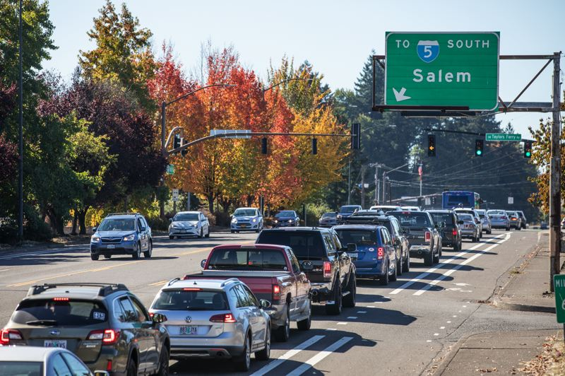 PORTLAND TRIBUNE: JONATHAN HOUSE - Vehicles line up at the intersection of Southwest Barbur Boulevard, Southwest Taylors Ferry Road and Southwest Capitol Highway. A new MAX line on Barbur  is proposed to reduce congestion.