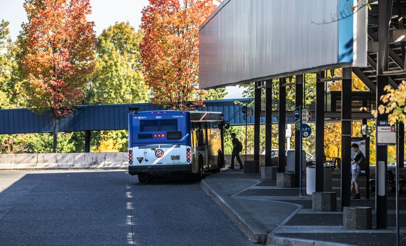 PORTLAND TRIBINE: JONATHAN HOUSE - A bus picks up a passenger at the Southwest Barbur Transit Center, the future of its park-and-ride lot is in doubt.
