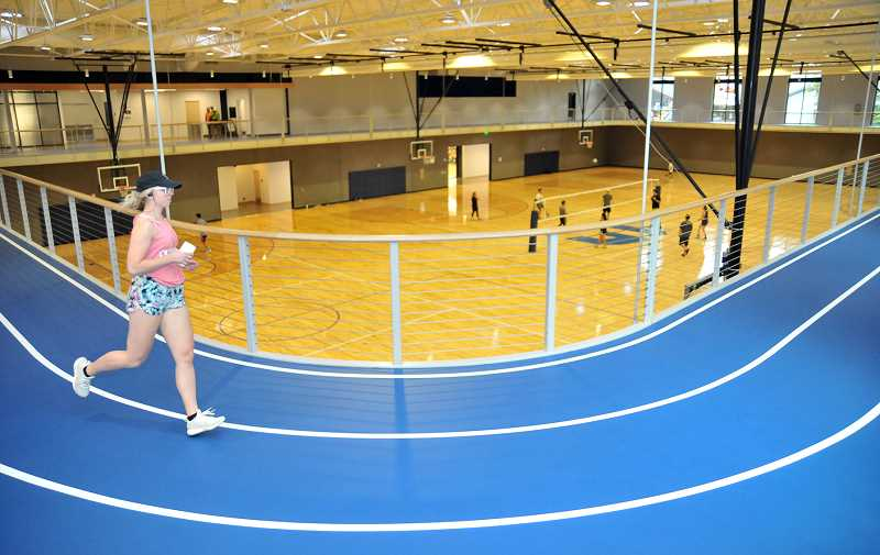 GARY ALLEN - Students on the indoor running track (above) and cardio deck and weight room (below) take full advantage of the recently opened Hadlock Center at GFU.