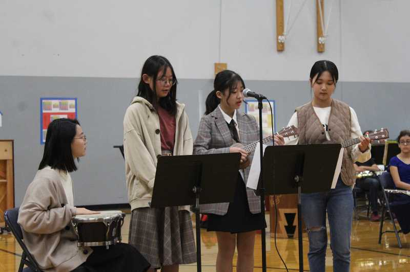 HERALD PHOTO: KRISTEN WOHLERS - Gangbuk students perform songs at the welcoming ceremony on Monday, Oct. 15.