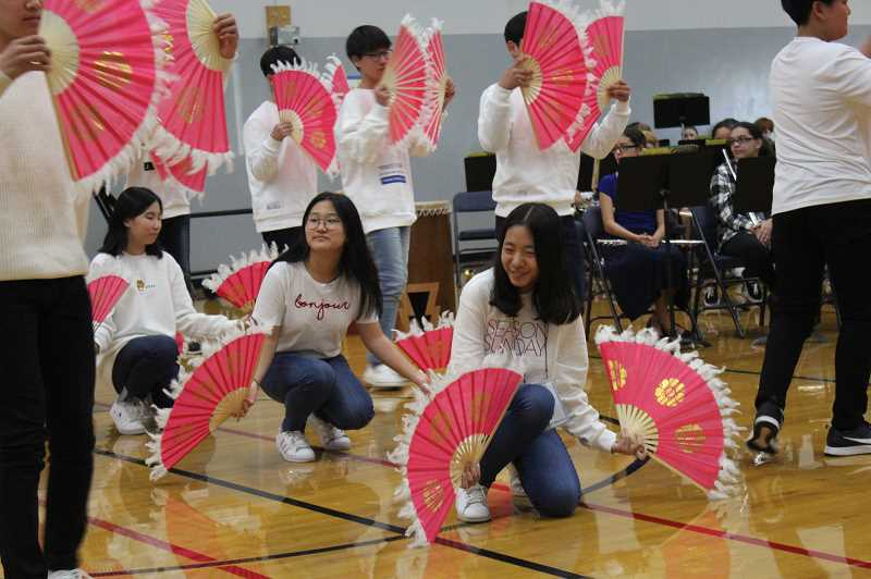 HERALD PHOTO: KRISTEN WOHLERS - Gangbuk students perform a dance at the welcoming ceremony.