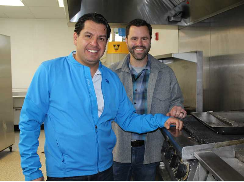 HOLLY M. GILL/MADRAS PIONEER - Roberto Cardenas, left, the owner of the new Madras Brewing Co., and Nick Snead, director of the Madras Community Development Department, are pictured in the kitchen of the former Geno's Italian Grill, in the Harriman Building. Cardenas anticipates opening the restaurant, which will feature brews from Mystic Roots Brewing, next month.