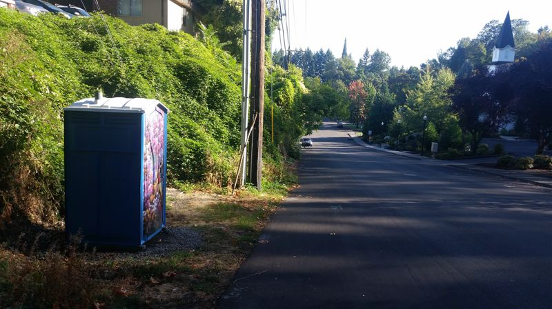 PHOTO BY: RAYMOND RENDLEMAN - Oregon City placed an Arta Pottie in the right-of-way on John Adams Street, near the Father's Heart Street Ministry and Barclay Park.