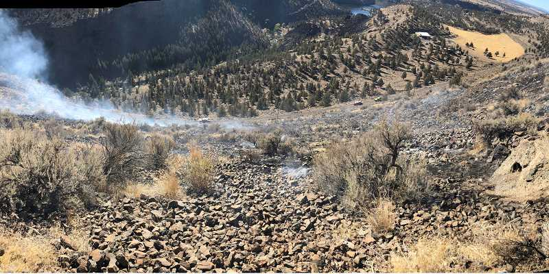 SUBMITTED PHOTO - Firefighters respond to a fire in Willow Creek Canyon northwest of Madras, called in at 1:07 p.m. on Oct. 11. The fire was from an escaped open burn.