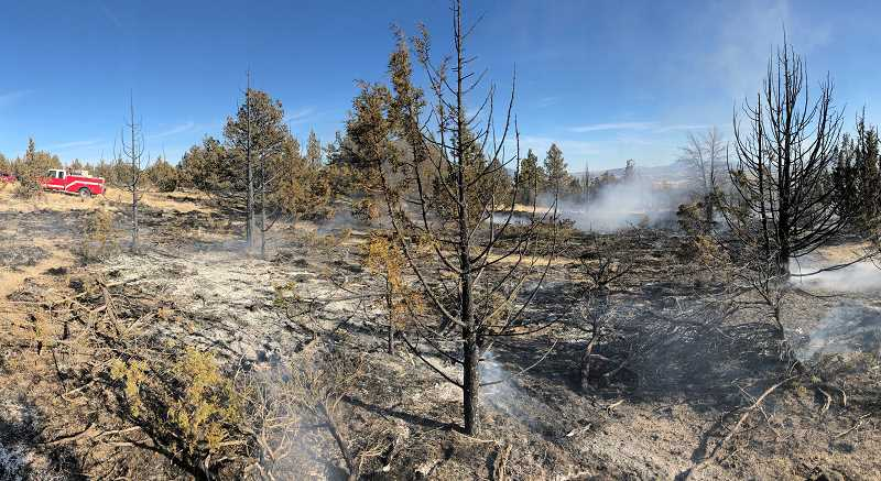 SUBMITTED PHOTO - A fire on Rocky Lane, on the west side of Round Butte, escaped from a burning barrel last Thursday afternoon, Oct. 11. Firefighters were called to the scene at 3:07 p.m., after responding to an earlier fire from an escaped open burn.