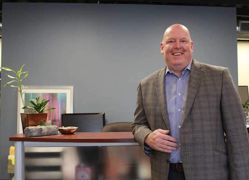 REVIEW PHOTO: SAM STITES - Troy Reichlein has 24 years of accounting experience as a CPA. He's now dispensing that expertise from new offices on Second Street in downtown Lake Oswego.