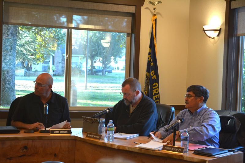 SPOTLIGHT PHOTO: COURTNEY VAUGHN - Port commissioners Larry Ericksen, Robert Keyser and Patrick Trapp discuss matters during a board of commissioners meeting Wednesday, Oct. 17. Port commissioners approved a lease with a company that manufactures bumpers, solidifying the company's move into Columbia County.