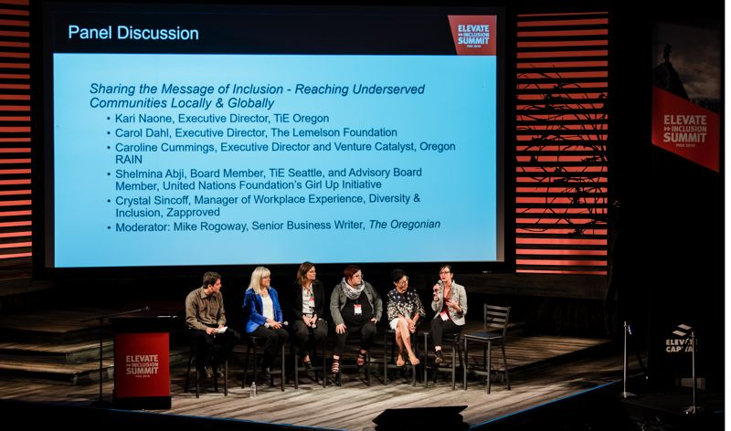 COUTESY: ELEVATE CAPITAL - Caroline Cummings (right) addresses the audience at the Elevate Inclusion Summit on October 12, 2018. Cummings and Oregon RAIN bring resoruces to help entrepreneurs in rural Oregon.
