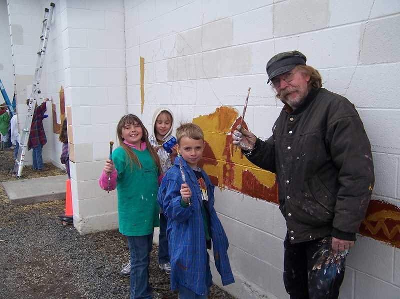 PHOTO COURTESY OF PAULINA SCHOOL  - Artist Ken Wolverton, right, and some Paulina School students work on the Buckaroo Mural in the spring of 2011.