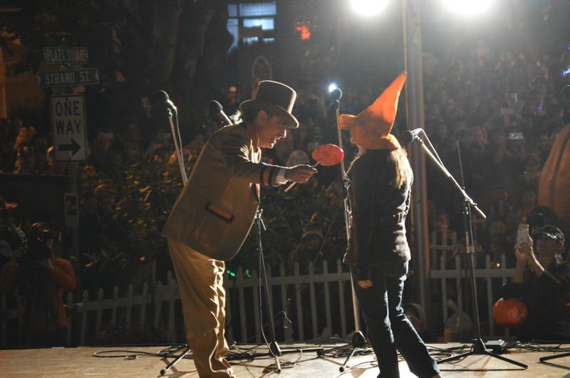 SPOTLIGHT PHOTO: NICOLE THILL-PACHECO - Actors from the Halloweentown movie Robin Thomas and Emily Roeske greet each other on stage during the Oct. 13 pumpkin lighting ceremony.