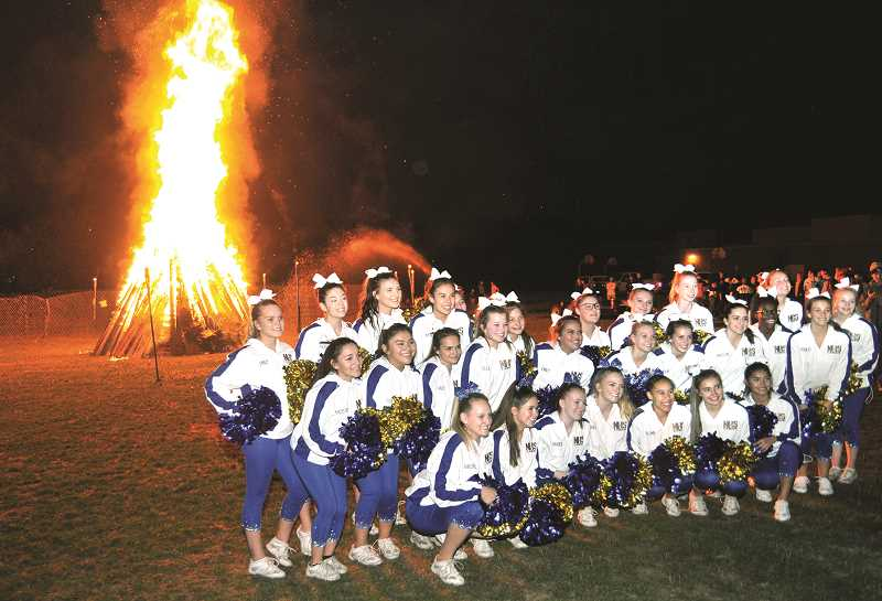 SETH GORDON - The Newberg Boosters have added new events and activities this fall, like the bonfire following a home cross-country meet Oct. 3, to keep kids engaged and built a sense of community. Their efforts have been part of many across the school district that have contributed to improved morale so far this school year.