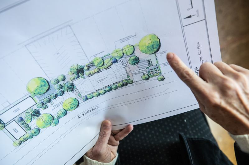 TRIBUNE PHOTO: JONATHAN HOUSE - Landscape architect Cathleen Corlett shows the planned improvements for site of a new family shelter on 92nd Avenue.