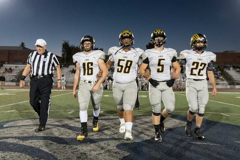 PHOTO COURTESY: GREG ARTMAN - The four captains of St. Helens gather before their Oct. 11 showdown with Wilsonville.