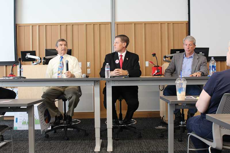 KRISTEN WOHLERS - Candidates for the U.S. House of Representatives debate at Clackamas Community College's Harmony Campus on Monday, Oct. 15. From left to right, they are Marvin Sandnes (PG-Salem), Mark Callahan (R-Oregon City) and incumbent Kurt Schrader (D-Canby).