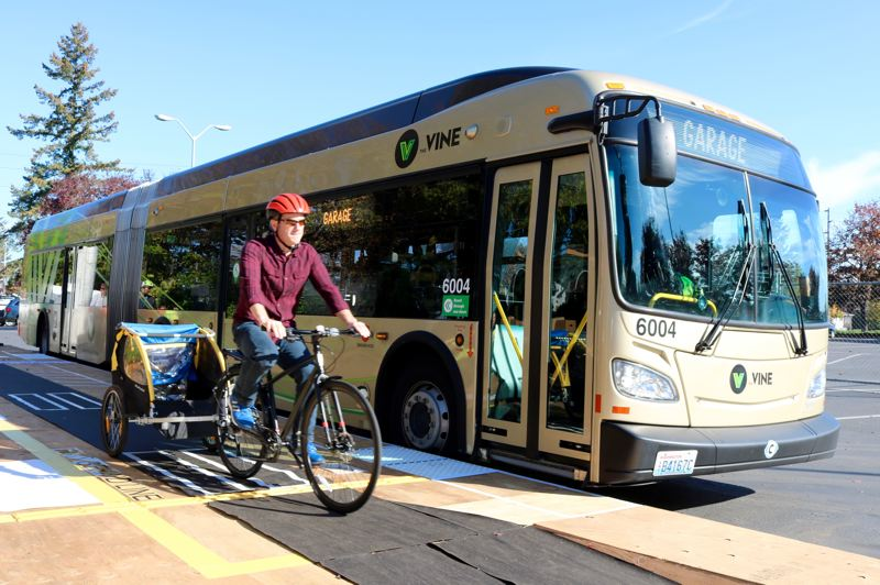 TRIBUNE PHOTO: ZANE SPARLING - Officials say bike riders will be expected to wait before crossing the new 18-feet-long elevated transit platforms on Divison Street while buses are docked.