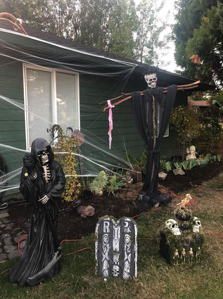 PHOTO COURTESY OF KRISTEN YOUNTS - Scappoose Halloween House offers a bevy of festive decorations and displays, including a graveyard and lights and music at night.