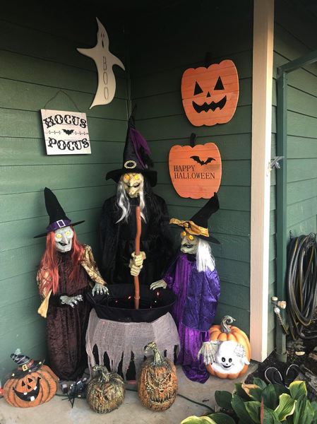 PHOTO COURTESY OF KRISTEN YOUNTS - A coven of witches graces an entryway at the Scappoose Halloween House. The home in Scappoose is decked out with displays for the month of October.