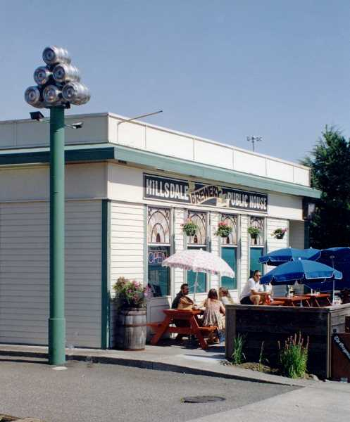 PHOTO PROVIDED BY MCMENAMINS - The open-air patio at the historic Hillsdale Brewery  and Public House.  The light pole on the left with six empty kegs on top still stands.
