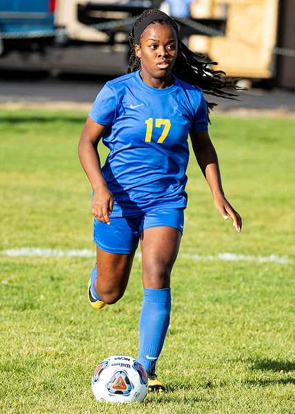 LON AUSTIN/CENTRAL OREGONIAN - Zoe Guthrie plays the ball up the field in a match earlier this year. Guthrie scored the Cowgirls' lone goal in their 6-1 loss to Hood River Valley this past Tuesday.