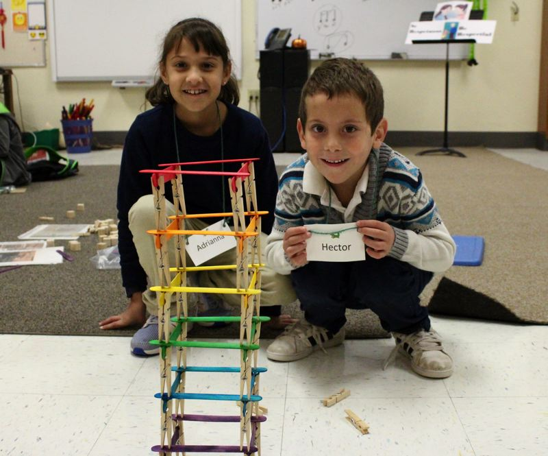 STAFF PHOTO: OLIVIA SINGER - Cornelius Elementary second grader Adrianna and kindergartener Hector built a structure using popsicle sticks and clothespins during the STEM club.