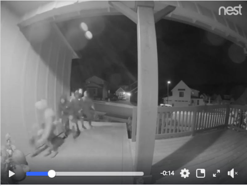 PHOTO COURTESY: CITY OF HAPPY VALLEY - A screen shot from a surveillance video shows a group of teenagers running up to a porch in Happy Valley to steal and destroy pumpkins.