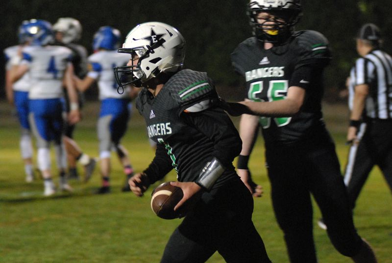 ESTACADA NEWS: MATT RAWLINGS - Nick Keller heads back to the sideline after scoring his second touchdown of the game in Estacada's 28-20 win over Crook County.