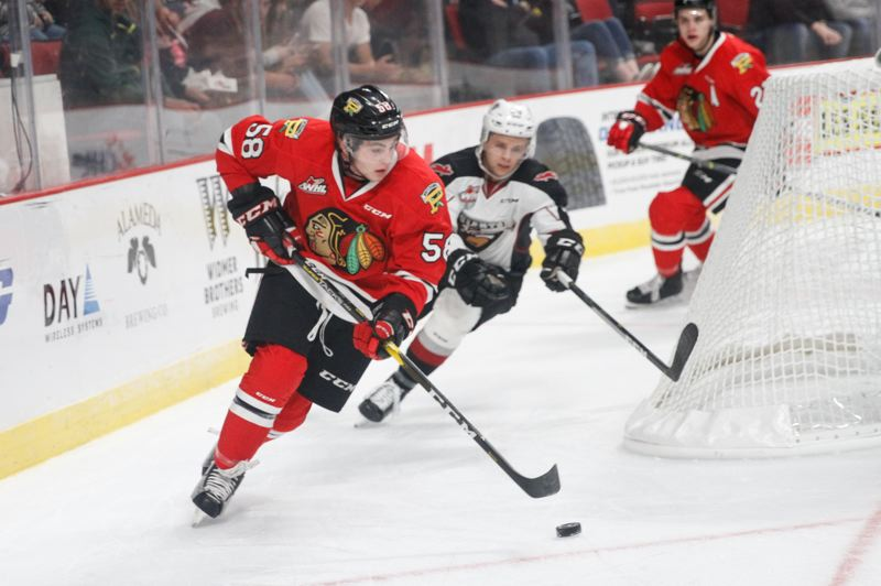 COURTESY: PORTLAND WINTERHAWKS/KEITH DWIGGINS - Portland Winterhawks defensemen Clay Hanus controls the puck against the Vancouver Giants on Friday night at Moda Center.