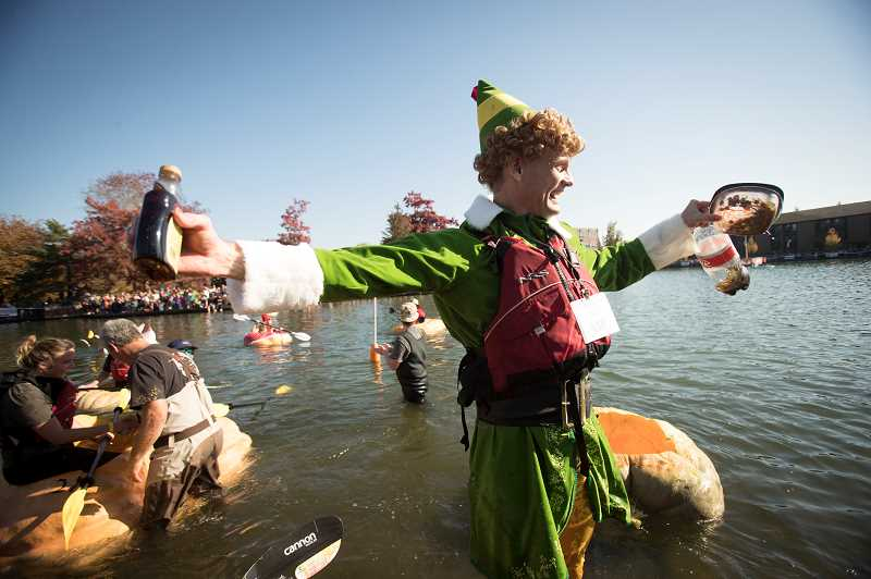 TIMES PHOTO: JAIME VALDEZ - Buddy the Elf, aka Gary Kristensen of Happy Valley, took first place in the first heat of the West Coast Giant Pumpkin Regatta held Saturday at the Lake at Tualatin Commons.