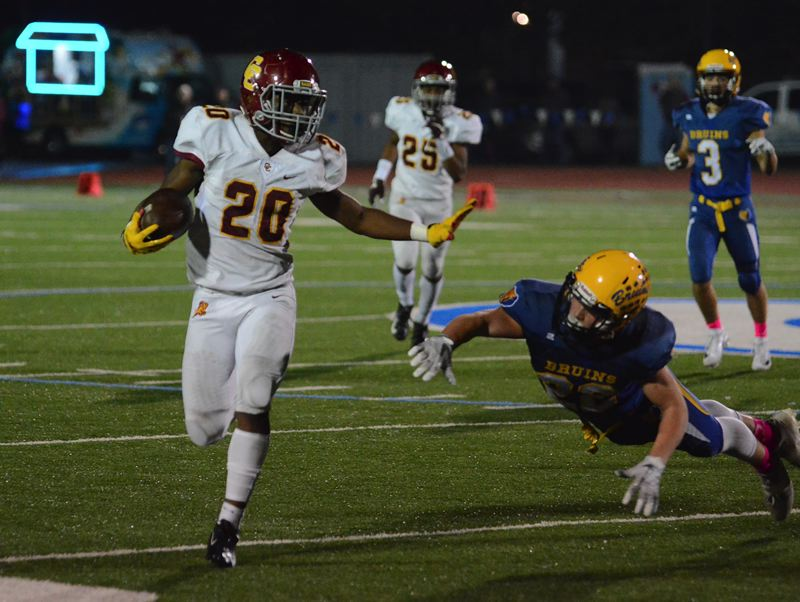 OUTLOOK PHOTO: DAVID BALL - Central Catholic running back Elijah Elliott gets past a diving Josh Nomie to scoot out of bounds for a first down. He scored the winning touchdown on a 65-yard scamper with 2:12 to play.