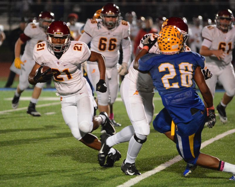 OUTLOOK PHOTO: DAVID BALL - Central Catholics Miles Jackson looks to get around the corner against Barlow linebacker Jobi Malary on a run in the fourth quarter.