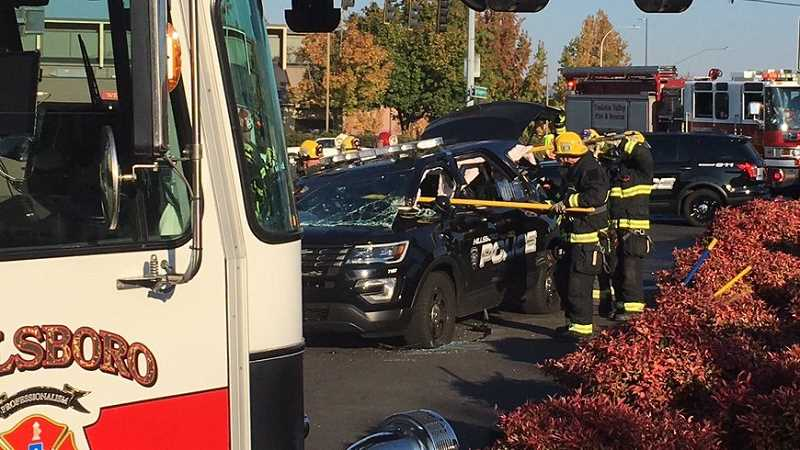 COURTESY HILLSBORO FIRE DEPARTMENT  - A Hillsboro police car was struck by a pickup truck at 185th Avenue and Evergreen Road while responding to a call. The vehicle reportedly had its lights and sirens on at the time of the crash.