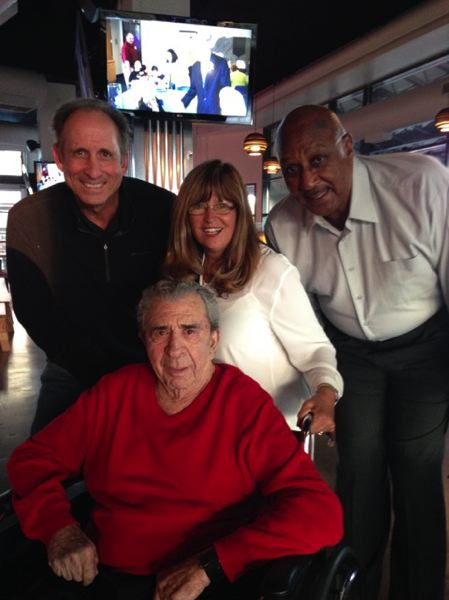 COURTESY: LORI SPENCER - Lori Spencer is surrounded by Trail Blazers founder Harry Glickman (front row) and former stars Bob Gross (back left) and Lloyd Neal.