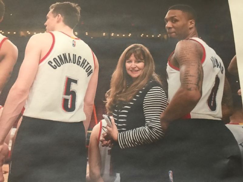 COURTESY: LORI SPENCER - Before a Blazers game, Lori Spencer chats with Damian Lillard (right) and Pat Connaughton.