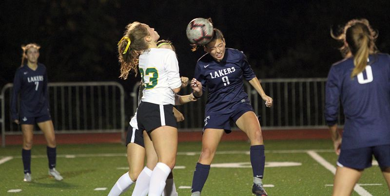 REVIEW PHOTO: MILES VANCE - Lake Oswego senior Taylor Jones makes a header during her team's 2-0 loss to West Linn on Oct. 18 at Lake Oswego High School.