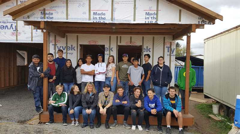 COURTESY PHOTO - Two groups of students visited the site of a Habitat for Humanity build in Mt. Angel.