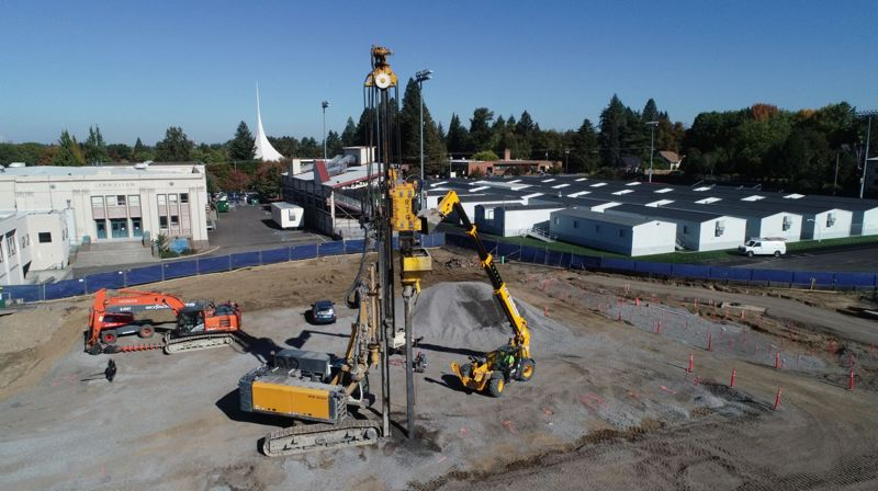 PHOTO BY: ALVARO FONTAN - Most students at Milwaukie High School are having to attend classes in portables on the track, as seen in this aerial image of construction activities.