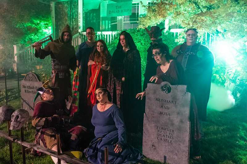 STAFF PHOTO: CHRISTOPHER OERTELL - The Dread Keep group, Dale Koch, John Mercer, Kyrissa Gieszler, Amber Van Winkle, Brian Huffman Walddon, Jessica Jensen, Hannah Edgington, Tyson Gieszler and Edan Koch ,pose at their haunted house on N.E. Estate Drive in Hillsboro.